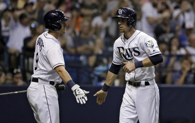 Tampa Bay Rays' Matt Duffy, right, celebrates with Jake Bauers (9) after scoring on a sacrifice fly by C.J. Cron off New York Yankees starting pitcher CC Sabathia during the fifth inning of a baseball game Friday, June 22, 2018, in St. Petersburg, Fla. (AP Photo/Chris O'Meara)