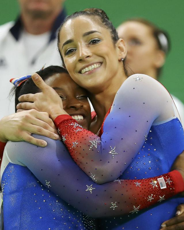 2016 Rio Olympics - Artistic Gymnastics - Final - Women's Floor Final - Rio Olympic Arena - Rio de Janeiro, Brazil - 16/08/2016. Simone Biles (USA) of USA (L) and Alexandra Raisman (USA) of USA (Aly Raisman) celebrate winning the gold and the silver respectively. REUTERS/Mike Blake FOR EDITORIAL USE ONLY. NOT FOR SALE FOR MARKETING OR ADVERTISING CAMPAIGNS.