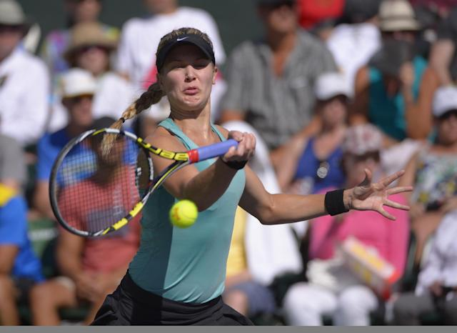 Eugenie Bouchard, of Canada, makes a return against Sara Errani, of Italy, during a match at the BNP Paribas Open tennis tournament on Sunday, March 9, 2014, in Indian Wells, Calif. (AP Photo/Mark J. Terrill)