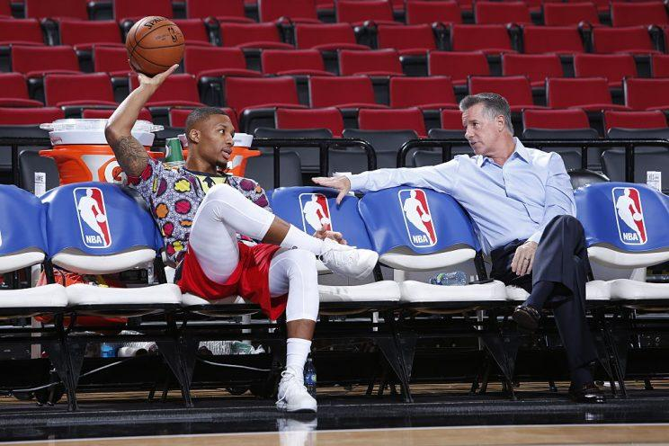 Blazers star Damian Lillard and general manager Neil Olshey try to figure out how to make a splash. (Getty Images)