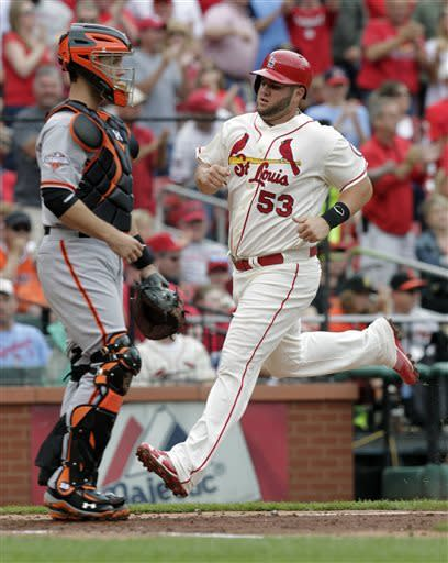 St. Louis Cardinals' Matt Adams (53) scores from first on a two-run double by Tony Cruz in the third inning of the first baseball game of a doubleheader against the San Francisco Giants, Saturday, June 1, 2013 in St. Louis.(AP Photo/Tom Gannam)