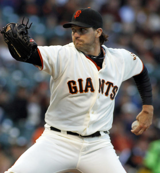 San Francisco Giants pitcher Barry Zito throws to the Atlanta Braves during the first inning of a baseball game in San Francisco, Thursday, Aug. 23, 2012. (AP Photo/George Nikitin)