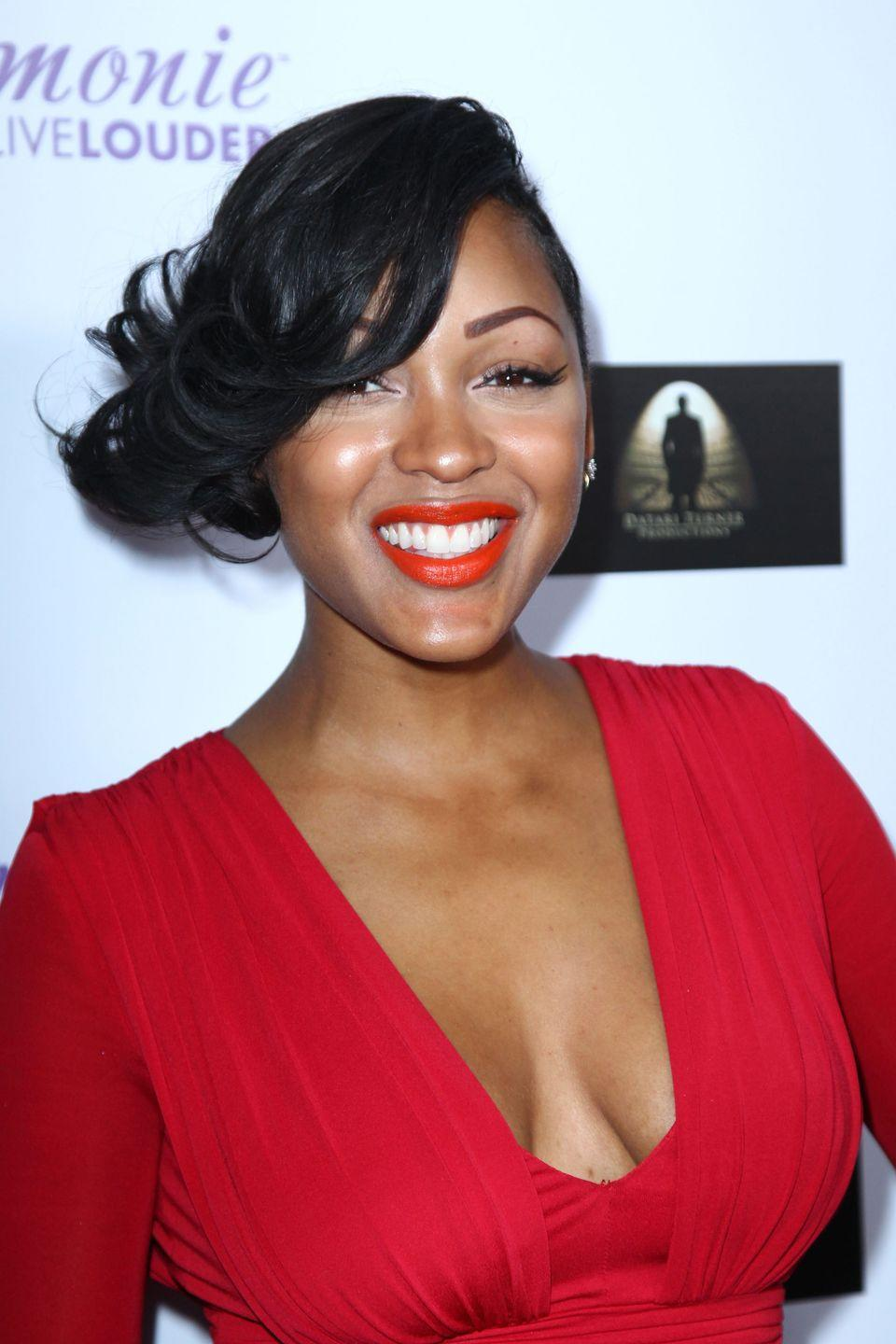 """<p>Actress <strong>Meagan Good</strong> served classic Hollywood glamour with <a href=""""https://www.goodhousekeeping.com/beauty/makeup/g2771/best-red-lipstick-for-all-skin-tones/"""" rel=""""nofollow noopener"""" target=""""_blank"""" data-ylk=""""slk:cherry red lipstick"""" class=""""link rapid-noclick-resp"""">cherry red lipstick</a> and a short cut with <a href=""""https://www.goodhousekeeping.com/beauty/hair/g3014/how-to-get-beach-waves-hair/"""" rel=""""nofollow noopener"""" target=""""_blank"""" data-ylk=""""slk:waves of hair"""" class=""""link rapid-noclick-resp"""">waves of hair</a> in the front. Her whimsical curls can be achieved by blending in <a href=""""https://www.goodhousekeeping.com/beauty/hair/g28449501/best-hair-extensions/"""" rel=""""nofollow noopener"""" target=""""_blank"""" data-ylk=""""slk:clip-in extensions"""" class=""""link rapid-noclick-resp"""">clip-in extensions</a>. </p><p><a class=""""link rapid-noclick-resp"""" href=""""https://www.amazon.com/Best-Sellers-Beauty-Hair-Extensions/zgbs/beauty/702379011?tag=syn-yahoo-20&ascsubtag=%5Bartid%7C10055.g.2471%5Bsrc%7Cyahoo-us"""" rel=""""nofollow noopener"""" target=""""_blank"""" data-ylk=""""slk:SHOP HAIR EXTENSIONS"""">SHOP HAIR EXTENSIONS </a></p>"""