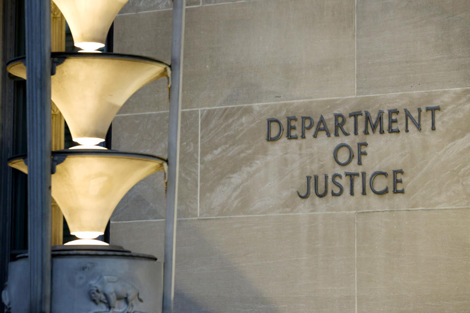 The Department of Justice is seen, Friday, March 22, 2019, in Washington. The Justice Department under former President Donald Trump secretly seized data from the accounts of at least two Democratic lawmakers in 2018 as part of an aggressive crackdown on leaks related to the Russia investigation and other national security matters, according to three people familiar with the seizures. (AP Photo/Alex Brandon)