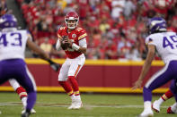 Kansas City Chiefs quarterback Patrick Mahomes drops back to pass during the first half of an NFL football game against the Minnesota Vikings Friday, Aug. 27, 2021, in Kansas City, Mo. (AP Photo/Charlie Riedel)