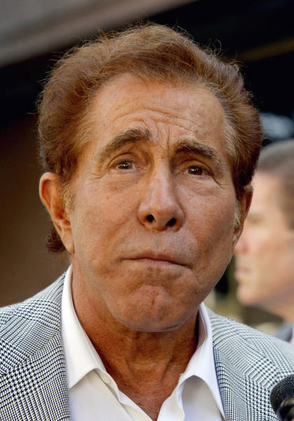"""FILE - This Sept. 7, 2012 file photo shows casino mogul Steve Wynn arriving at court for his slander trial in Los Angeles. Wynn on Tuesday Sept. 11, 2012, was awarded $20 million in punitive damages against """"Girls Gone Wild"""" creator, Joe Francis in his defamation lawsuit. (AP Photo/Nick Ut)"""