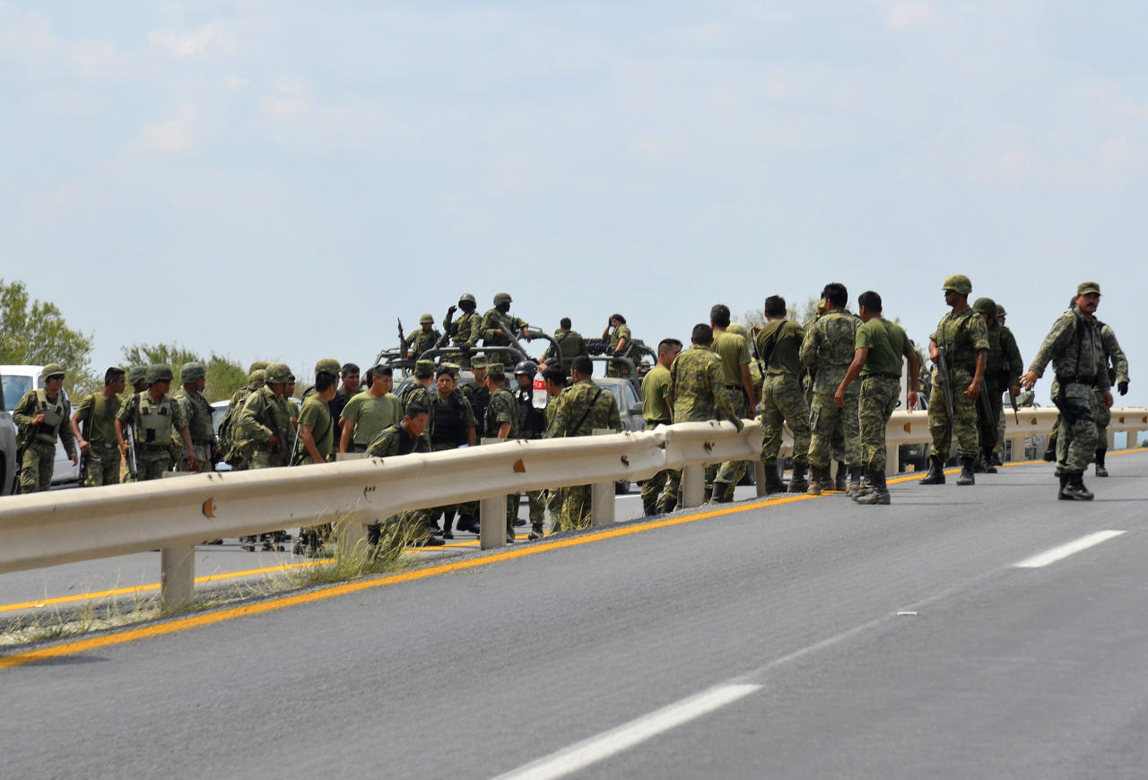 Mexican army soldiers arrive to aid after an explosion ripped through a gas pipeline distribution center in Reynosa, Mexico near Mexico's border with the United States, Tuesday Sept. 18, 2012. (AP Photo/El Manana de Reynosa)