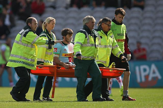 Demetri Catrakilis of Harlequins leaves the field after suffering an injury