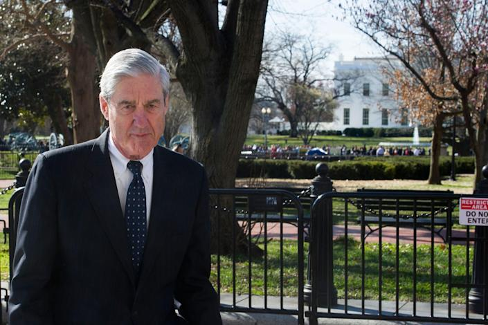 With the White House in the background special counsel Robert Mueller walks to St. John's Episcopal Church, for morning services, across from the White House, in Washington, March 24, 2019.