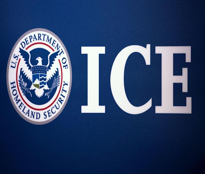 The Immigration and Customs Enforcement (ICE) seal is seen before a press conference discussing ongoing enforcement efforts to combat human smuggling along the Southwest border of the United States on 22 July 2014 at ICE headquarters in Washington, DC ((AFP via Getty Images))