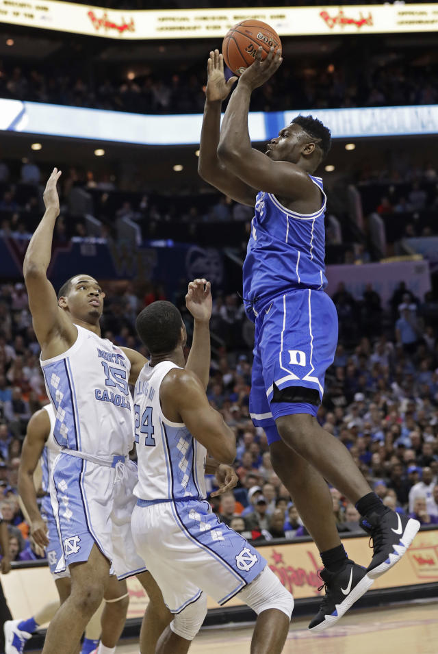 Duke's Zion Williamson (1) shoots against North Carolina's Garrison Brooks (15) during the first half of an NCAA college basketball game in the Atlantic Coast Conference tournament in Charlotte, N.C., Friday, March 15, 2019. (AP Photo/Chuck Burton)