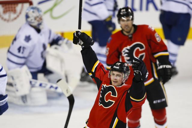 Calgary Flames' Matt Stajan, front, celebrates his goal against the Toronto Maple Leafs during the second period of an NHL hockey game in Calgary, Alberta, Wednesday, Oct. 30, 2013. (AP Photo/The Canadian Press, Jeff McIntosh)