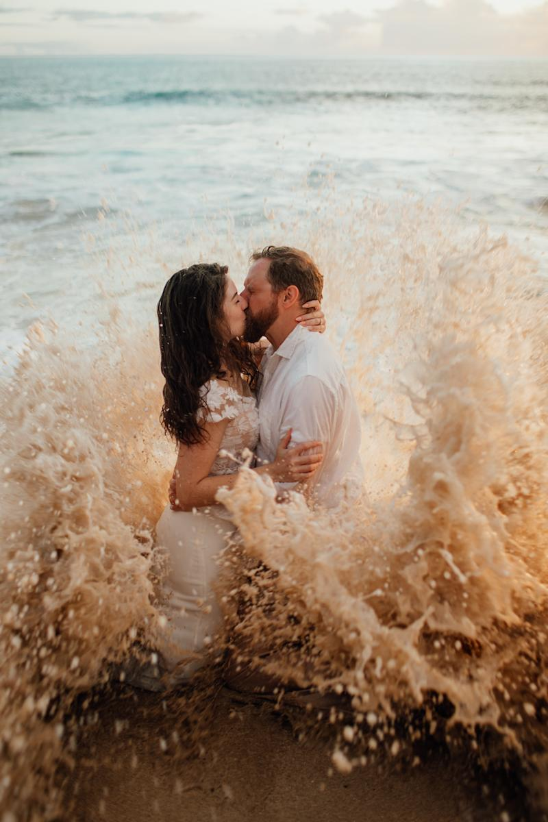 Bekah Blakely-Savage and husband Tim were taken out by a wave during their wedding photo shoot. (Photo: Courtesy of Sunny Golden)