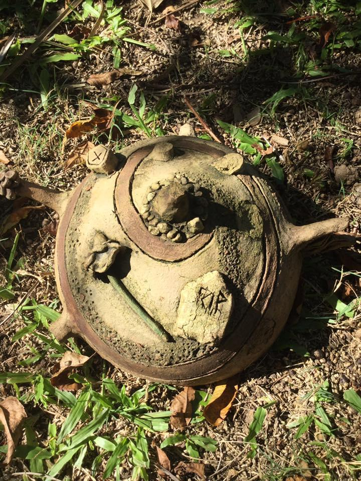 The ceramic ball has a rose and headstone that says RIP moulded onto it.