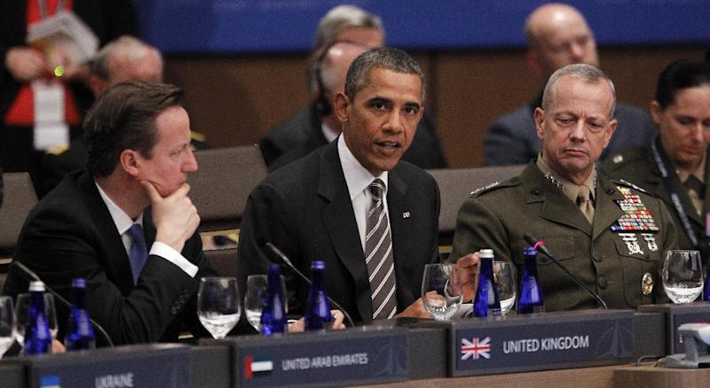 President Barack Obama speaks at the start of the International Security Assistance Force (ISAF) meeting on Afghanistan at the NATO Summit in Chicago, Monday, May 21, 2012. From left are, British Prime Minister David Cameron, left, and Gen. John R. Allen, Commander of the International Security Assistance Force. (AP Photo/Pablo Martinez Monsivais)