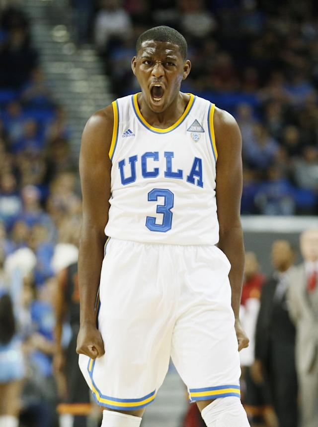 UCLA's Jordan Adams celebrates after scoring a three-point basket against Southern California during the first half of an NCAA college basketball game on Sunday, Jan. 5, 2014, in Los Angeles. (AP Photo/Danny Moloshok)