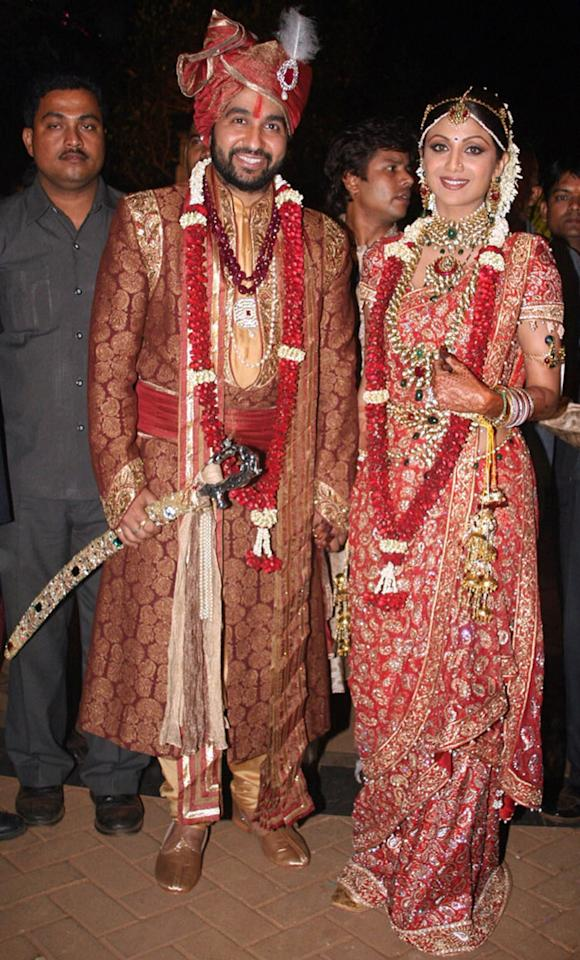 <p>Shilpa Shetty got married to a business tycoon – no less of a King, so it was only obvious that she would dress up like an empress draped in an extravagant sari designed by Tarun Tahiliani. The red sari, with its 8000 Swarovski crystals, was valued at a whopping 50 lakhs. The Big Brother winner channeled inner nobility in her grand kundan jewelry, embellished with uncut diamonds and emeralds. </p>