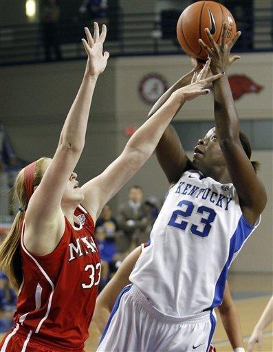 Kentucky's Samarie Walker, right, shoots under pressure from Miami (Ohio) forward Erica Almady during the first half of an NCAA college basketball game at Memorial Coliseum in Lexington, Ky., Wednesday, Nov. 28, 2012. (AP Photo/James Crisp)