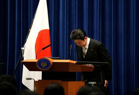 Japan's Prime Minister Shinzo Abe bows at a news conference after deciding on his cabinet following parliament reconvening after the general election, at his official residence in Tokyo, Japan November 1, 2017.  REUTERS/Toru Hanai