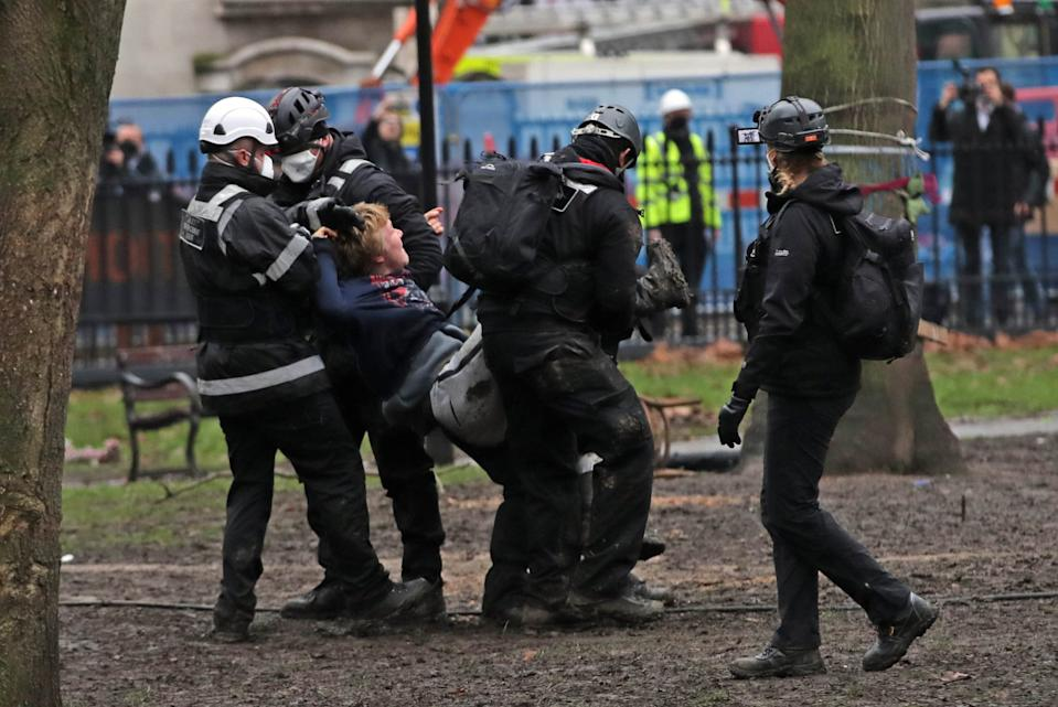 A protester is removed from the encampment in Euston Square Gardens in central London, where HS2 Rebellion protesters have built a 100ft tunnel network, which they are ready to occupy, after claiming the garden is at risk from the HS2 line development. Picture date: Wednesday January 27, 2021.