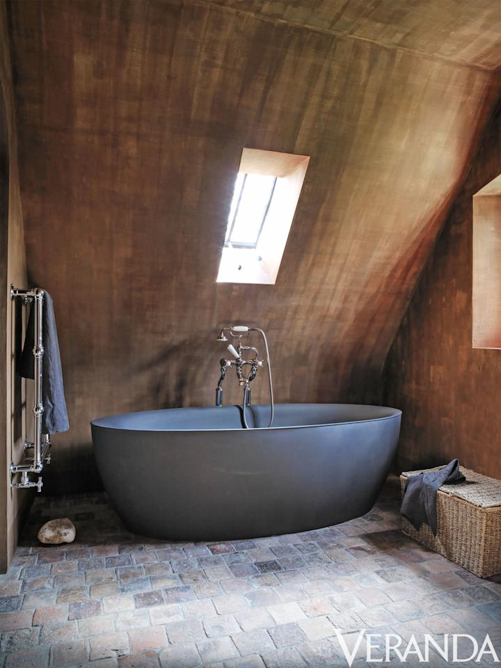 <p>A newly designed house in the Belgian countryside celebrates the locale's inherent charm. Take, for example, this modern tub that's paired with reclaimed terra-cotta tiles — a prime example of the rough but refined Belgian look. </p>