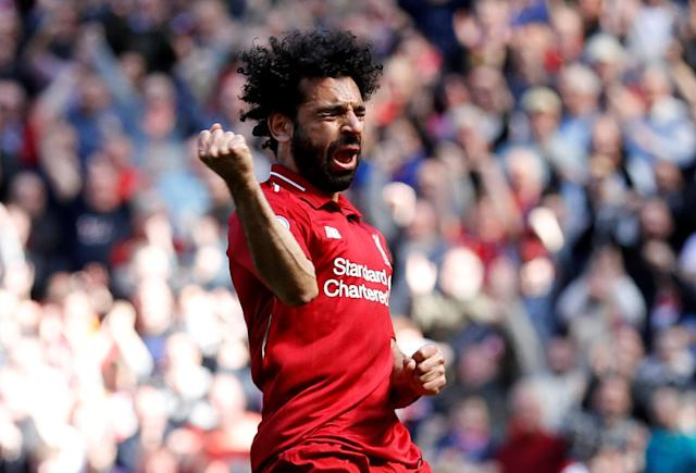 "Soccer Football - Premier League - Liverpool vs Brighton & Hove Albion - Anfield, Liverpool, Britain - May 13, 2018 Liverpool's Mohamed Salah celebrates scoring their first goal REUTERS/Phil Noble EDITORIAL USE ONLY. No use with unauthorized audio, video, data, fixture lists, club/league logos or ""live"" services. Online in-match use limited to 75 images, no video emulation. No use in betting, games or single club/league/player publications. Please contact your account representative for further details. TPX IMAGES OF THE DAY"