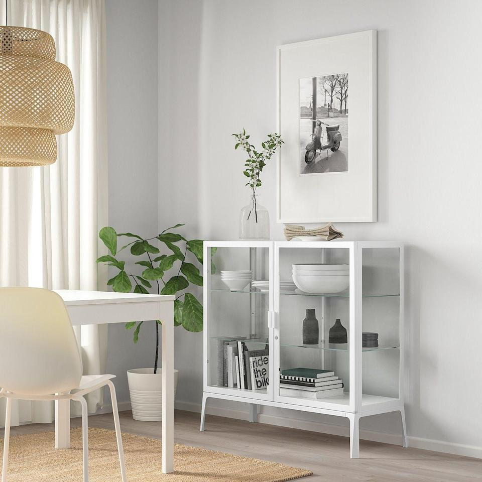 """<p><strong>IKEA</strong></p><p>ikea.com</p><p><strong>$179.00</strong></p><p><a href=""""https://go.redirectingat.com?id=74968X1596630&url=https%3A%2F%2Fwww.ikea.com%2Fus%2Fen%2Fp%2Fmilsbo-glass-door-cabinet-white-20452307%2F&sref=https%3A%2F%2Fwww.thepioneerwoman.com%2Fhome-lifestyle%2Fdecorating-ideas%2Fg35001978%2Fblanket-storage-ideas%2F"""" rel=""""nofollow noopener"""" target=""""_blank"""" data-ylk=""""slk:Shop Now"""" class=""""link rapid-noclick-resp"""">Shop Now</a></p><p>People typically think of glass display cabinets for <a href=""""https://www.thepioneerwoman.com/home-lifestyle/decorating-ideas/g32598574/kitchen-storage-ideas/"""" rel=""""nofollow noopener"""" target=""""_blank"""" data-ylk=""""slk:storing China"""" class=""""link rapid-noclick-resp"""">storing China</a>, but they work just as well for your favorite textiles. You'll need to fold your blankets neatly, but it's an easy way to store lots of blankets while showing off their patterns and colors. <br></p>"""