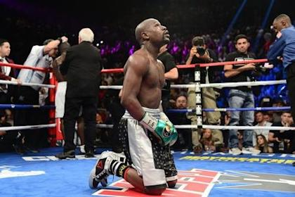 Floyd Mayweather kneels after the final round against Andre Berto (not pictured) in their WBA/WBC welterweight title bout at MGM Grand Garden. Mayweather won via unanimous decision. (Joe Camporeale/USA TODAY Sports)