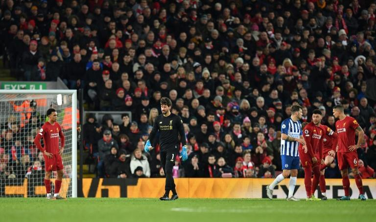 Liverpool held on for a 2-1 win over Brighton despite goalkeeper Alisson being sent off with under a quarter-of-an-hour remaining (AFP Photo/Paul ELLIS)