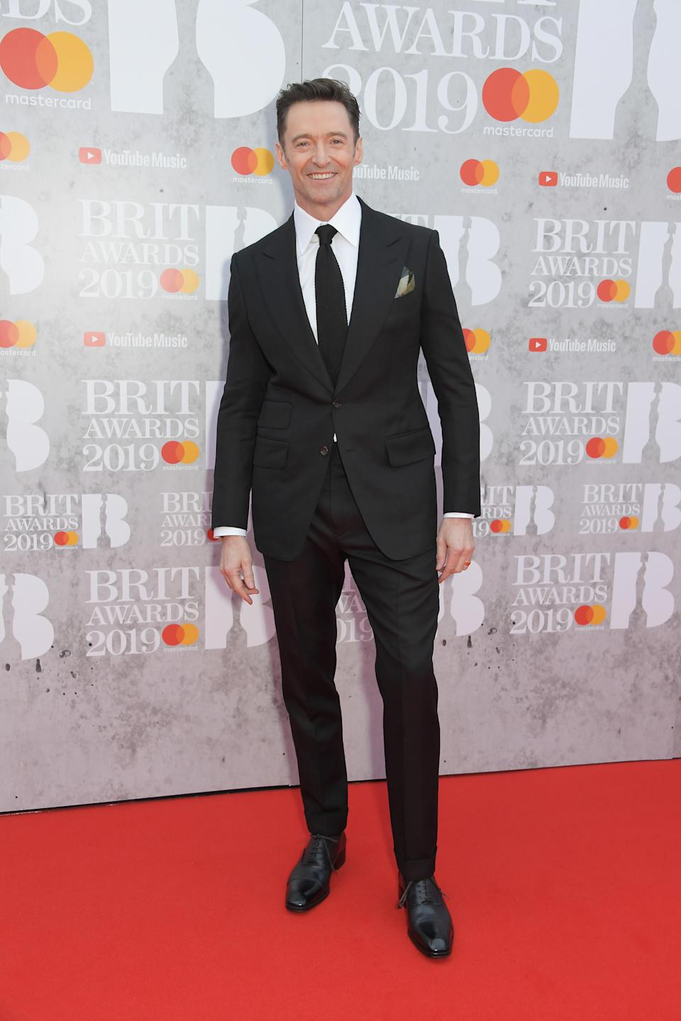 <p>Wearing a dark brown Tom Ford suit with a matching silk tie and leather shoes. <em>[Photo: Getty]</em> </p>