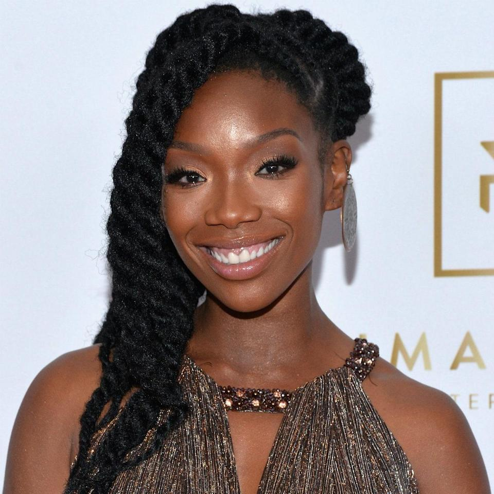 """""""One protective style that's often overlooked is the good old-fashioned two-strand twist,"""" says Brown. """"It's a great way for you to protect your hair, while keeping it moisturized and defined."""" While Brandy is wearing extensions, you can easily recreate this look on natural hair alone. Post-removal you'll be left with a """"beautifully curly 'fro"""" you can wear afterwards."""