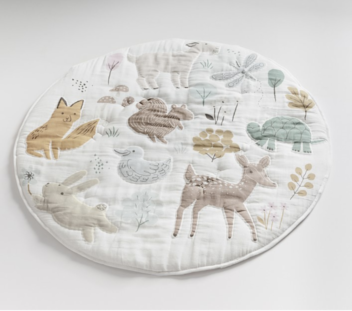 "$59, Pottery Barn Kids. <a href=""https://www.potterybarnkids.com/products/dakota-woodland-muslin-travel-play-mat/?pkey=cplaymat"" rel=""nofollow noopener"" target=""_blank"" data-ylk=""slk:Get it now!"" class=""link rapid-noclick-resp"">Get it now!</a>"