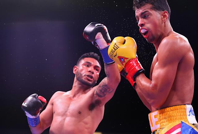 Andrew Cancio (L) lands a left against Alberto Machado (R) during the WBA super featherweight title bout at Fantasy Springs Casino on Feb. 9, 2019 in Indio, California. (Getty Images)