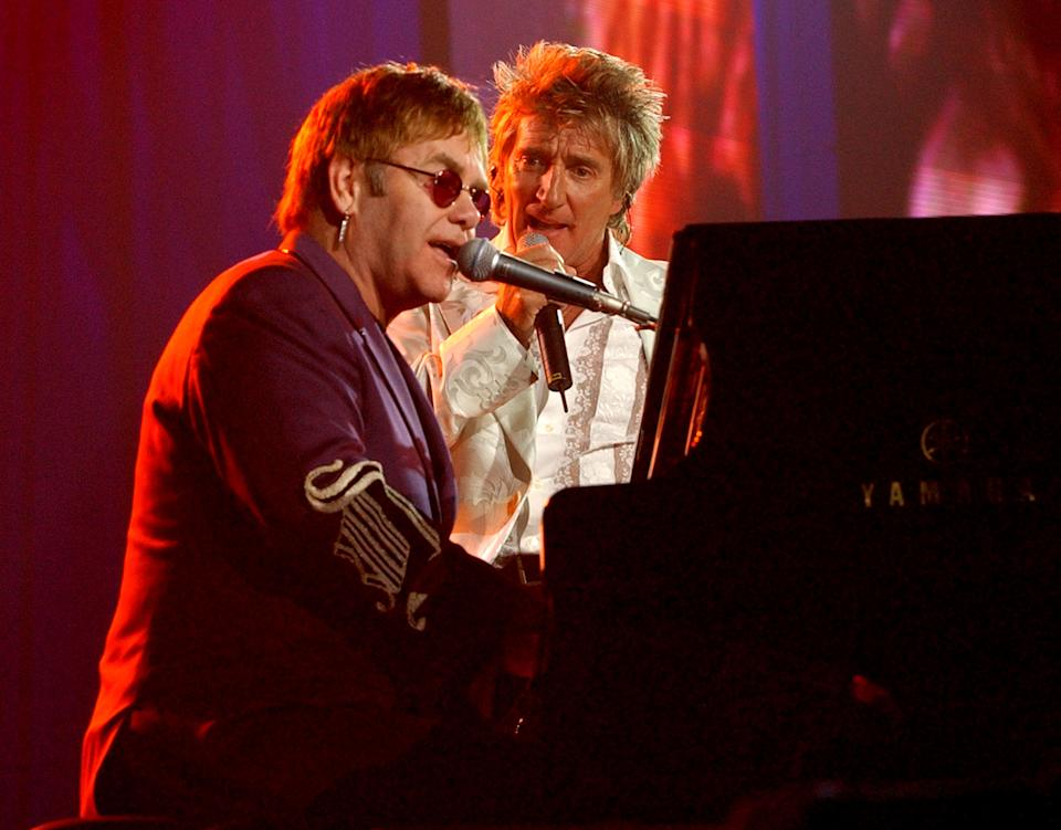 """Sir Elton John and Rod Stewart during The Andre Agassi Charitable Foundation's 7th """"Grand Slam for Children"""" Fundraiser - Show at The MGM Grand Hotel and Casino in Las Vegas, Nevada, United States. (Photo by KMazur/WireImage)"""