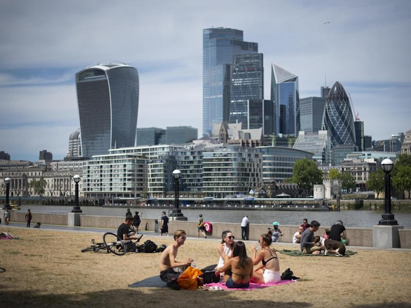 People enjoy the sun at Potters Field, London, on 2 June, 2020: Victoria Jones/PA Wire/PA Images