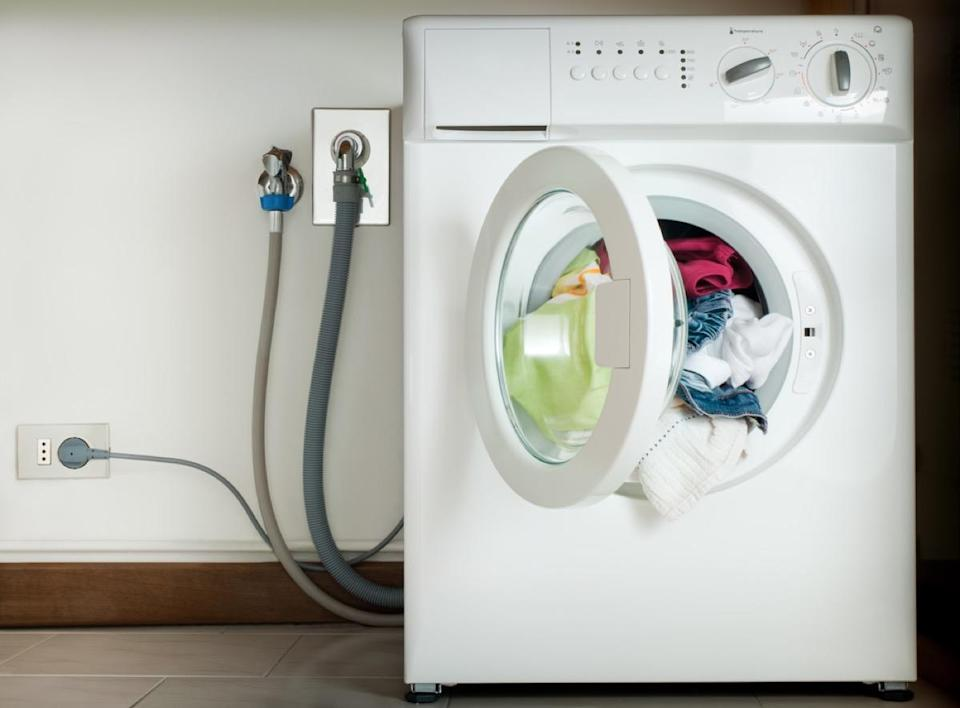 "If your <a href=""https://bestlifeonline.com/how-to-clean-washing-machine/?utm_source=yahoo-news&utm_medium=feed&utm_campaign=yahoo-feed"" rel=""nofollow noopener"" target=""_blank"" data-ylk=""slk:washing machine"" class=""link rapid-noclick-resp"">washing machine</a> hose looks lumpy, it's time to get a plumber to your house as soon as you can. Bulges in your machine's hose can mean that the hose's walls have weakened, meaning it could burst and cause a flood if it's not fixed in a timely manner."