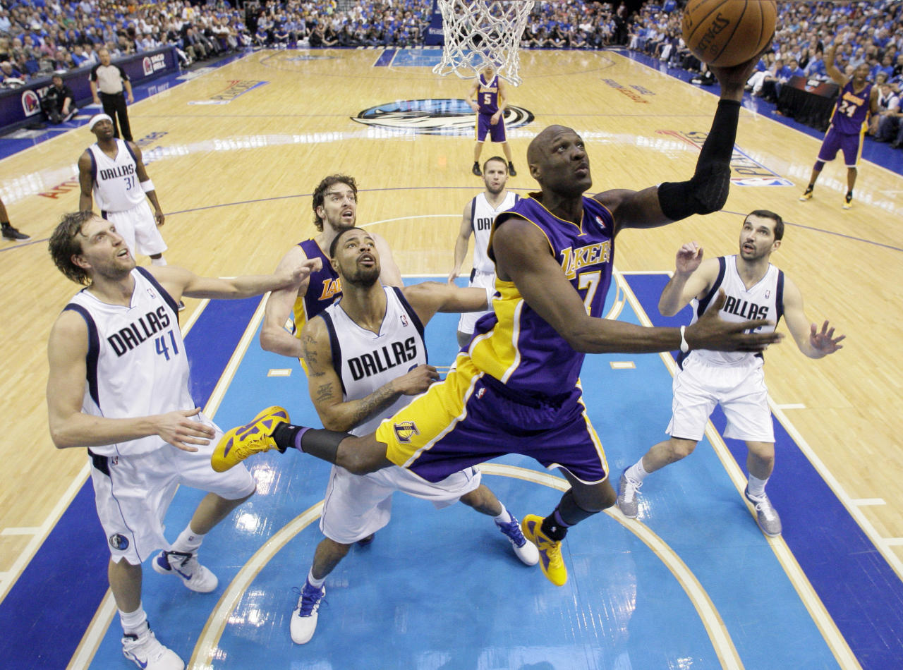 Los Angeles Lakers' Lamar Odom shoots against the Dallas Mavericks during the second half of Game 4 of a second-round NBA playoff basketball series, Sunday, May 8, 2011, in Dallas. The Mavericks won 122-86, sweeping the series.