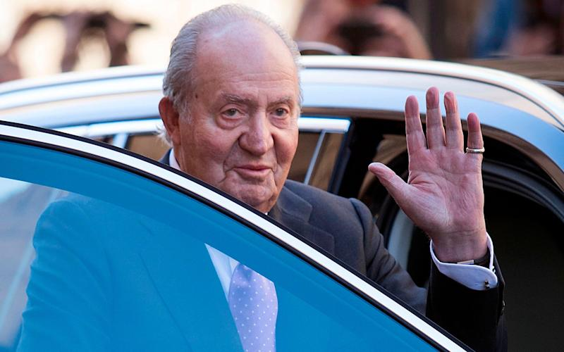 2018 Former King Juan Carlos I of Spain waves as he leaves after attending the traditional Easter Sunday Mass of Resurrection - AFP