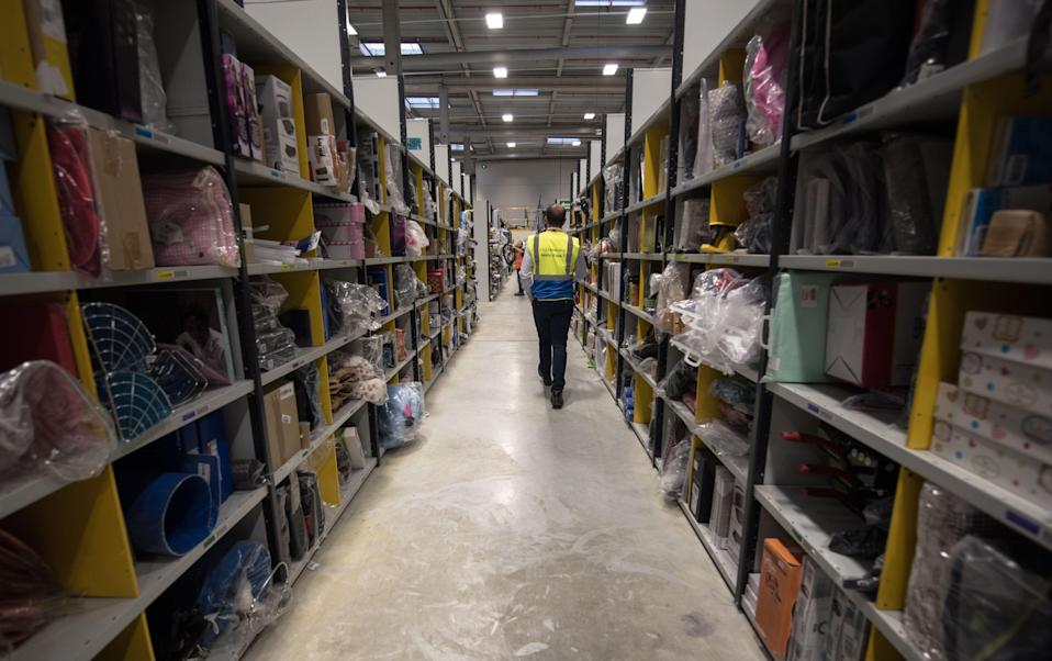 Amazon shed employees at a staggering rate during the pandemic, according to a new New York Times investigation. (AFP via Getty Images)