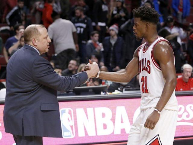"""Tom Thibodeau and <a class=""""link rapid-noclick-resp"""" href=""""/nba/players/4912/"""" data-ylk=""""slk:Jimmy Butler"""">Jimmy Butler</a> share a moment before the game. (Associated Press)"""