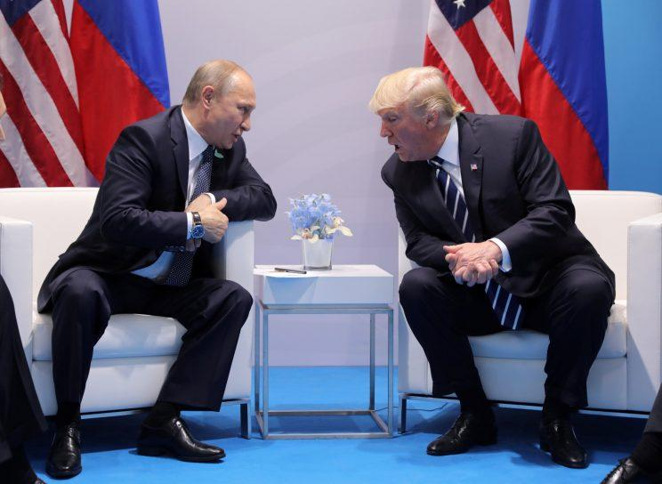 Russian President Vladimir Putin and President Trump talk at the G-20 summit in Hamburg, Germany, on Friday. (Carlos Barria/Reuters)