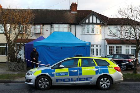 A police officer stands guard outside the home of Nikolai Glushkov in New Malden Britain