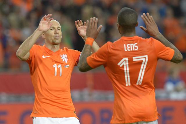 Netherlands player Jeremain Lens, right, celebrates scoring against Wales with teammate Arjen Robben during the international friendly soccer match at ArenA stadium in Amsterdam, Netherlands, Wednesday June 4, 2014. (AP Photo/Ermindo Armino)