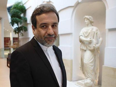 Iran's top nuclear negotiator Araqchi leaves a hotel after meeting senior officials from the United States, Russia, China, Britain, Germany and France in Vienna