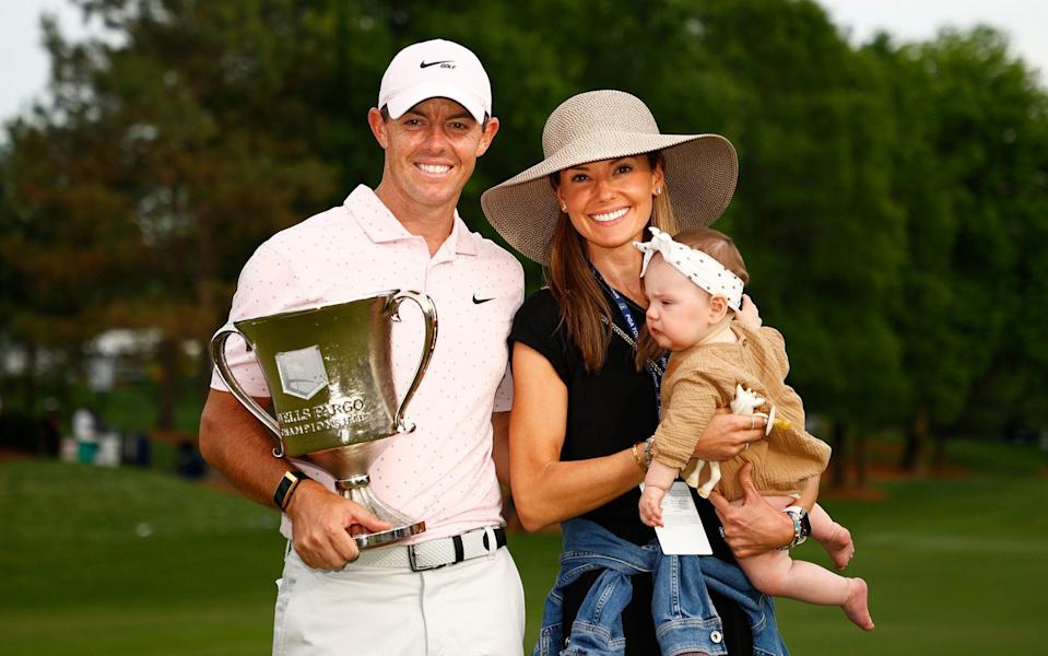 McIlroy was quick to celebrate with his young family - wife Erica and daughter Poppy - GETTY IMAGES