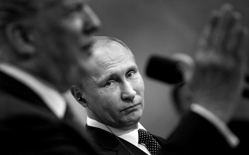 President Donald Trump's bewildering affinity for President Vladimir Putin raises the question of whether it's merely a matter of admiration or Putin possesses information that empowers him to influence Trump's conduct. (Photo: BRENDAN SMIALOWSKI / AFP / Getty Images)