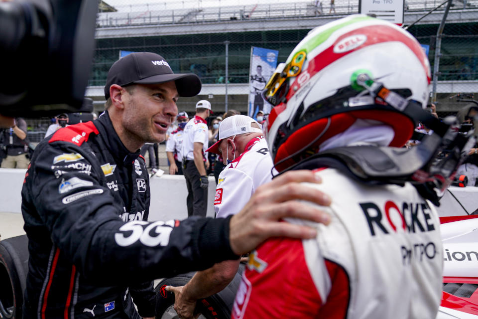 Will Power, left, of Australia, celebrates with Simona De Silvestro, of Switzerland, after they made the field during the last-row qualifications for the Indianapolis 500 auto race at Indianapolis Motor Speedway in Indianapolis, Sunday, May 23, 2021. (AP Photo/Michael Conroy)