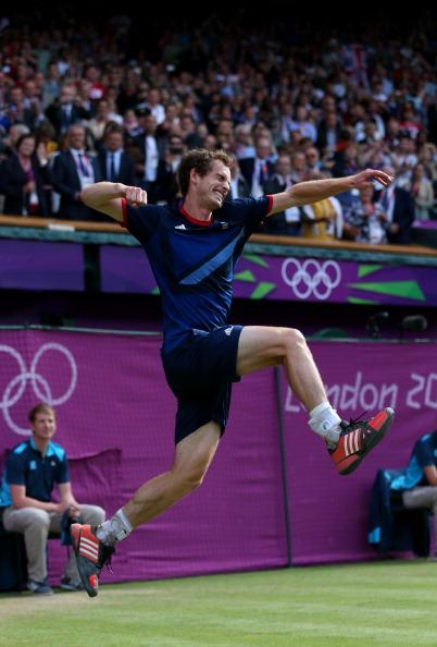 LONDON, ENGLAND - AUGUST 05:  Andy Murray of Great Britain celebrates defeating Roger Federer of Switzerland in the Men's Singles Tennis Gold Medal Match on Day 9 of the London 2012 Olympic Games at the All England Lawn Tennis and Croquet Club on August 5, 2012 in London, England. Murray defeated Federer in the gold medal match in straight sets 2-6, 1-6, 4-6.  (Photo by Clive Brunskill/Getty Images)