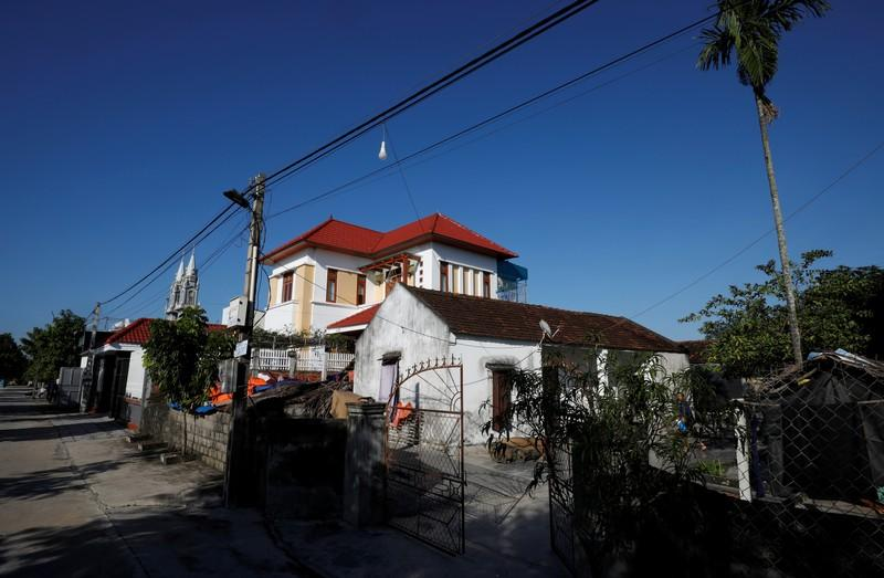 The newly-built house of Bui Chung, who worked in Britain, is seen next to an older house at Do Thanh commune, in Nghe An province