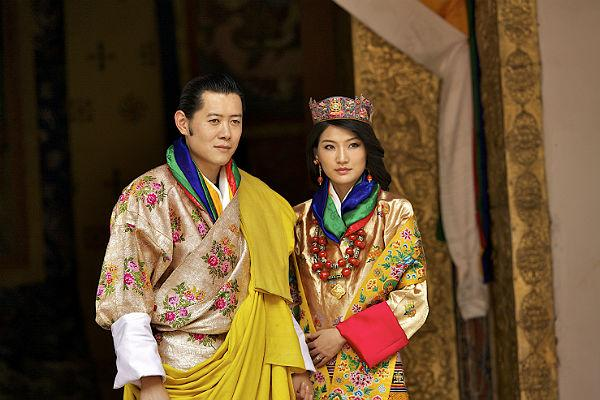 8. King Jigme Wanchuk and Jetsun Pema:  His majesty King Jigme Khesar Namgyel Wangchuck, 31, and Queen Jetsun Pema, 21, walk out after their marriage ceremony is completed on October 13, 2011 in Punakha, Bhutan.